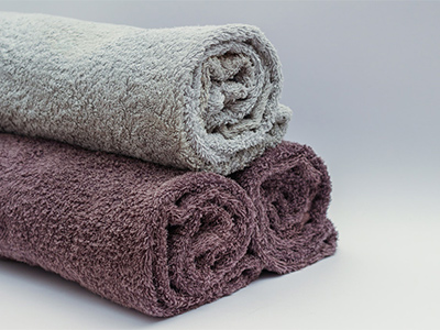 A rolled towel can give you support to improve posture